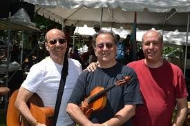 "David Buskin, Robin Batteau and Marshal Aaron Rosenberg out in the the sun ""in a field full of folkies""!"